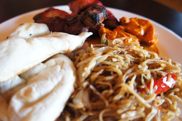 Photo by Kathy Tran and Scott Mitchell | Naan bread, Tandoori chicken, chicken masala and Hakka noodles share a plate