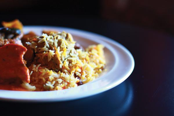 Photo by Kathy Tran  | The chicken biryani sits marinating in the chicken masala.