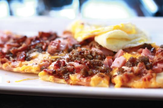 Photos by Kathy Tran and Scott Mitchell | The sausage, bacon, egg and cheese flatbread provides a hearty breakfast.