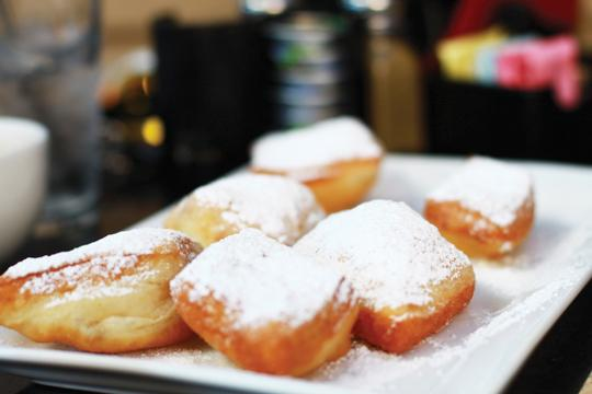 Photos by Kathy Tran and Scott Mitchell | The beignets, fluffy air-filled pastries covered in powdered sugar, offer a sweet dessert to go along with a latte.