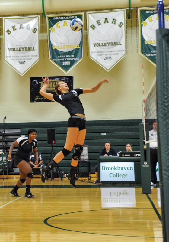 Photos by Scott Godbey and Maddox Price | leading the game in kills, middle blocker Cadyn Laing leaps for a successful shank