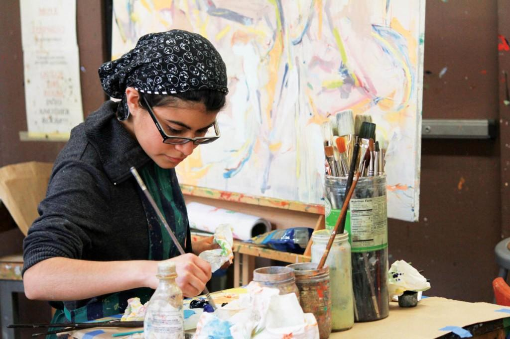 Photos by Nicholas Bostick | Brookhaven College art student Kenya Diaz finishes her painting. One of Diaz's paintings was accepted to be featured at the Founder's Foyer Rotating Art Exhibition.