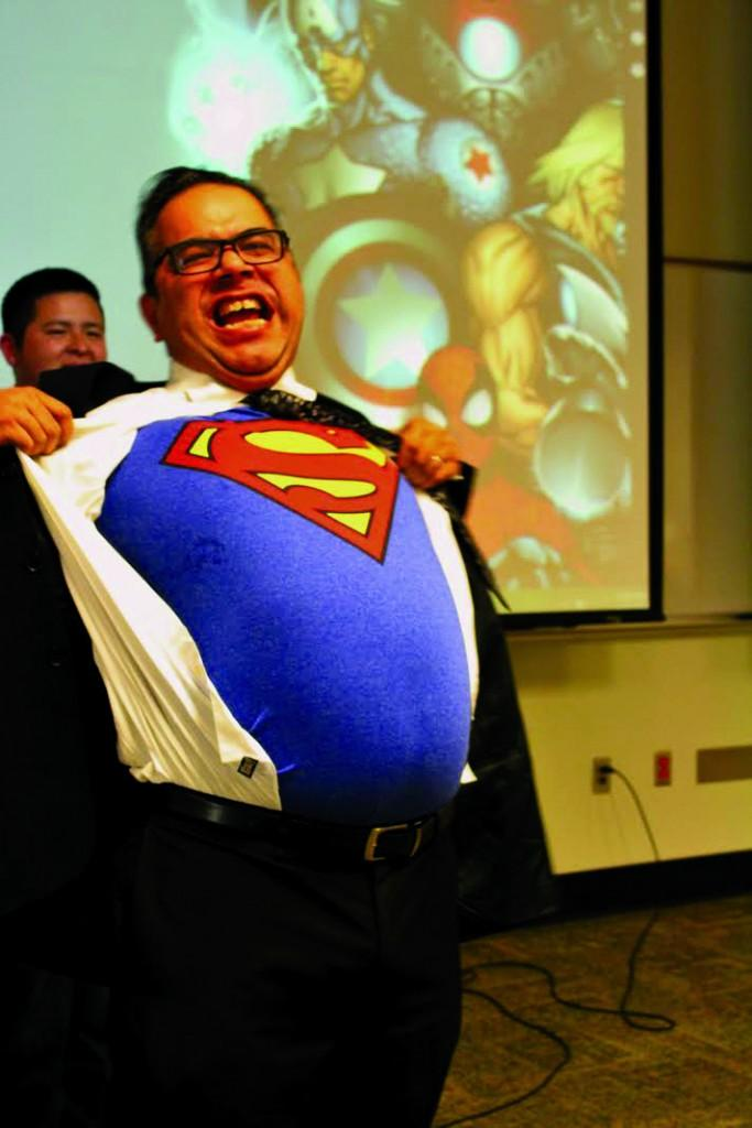 William De La Cruz | Courier       Brookhaven College librarian John Flores shows off his Superman shirt to kick off the event.