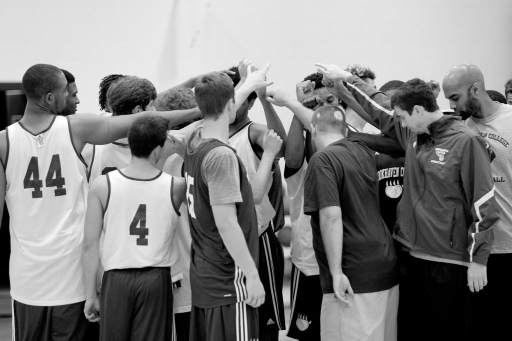 Photos by Ravin Lee | Coach Hurst rounds his team up in a huddle concluding practice