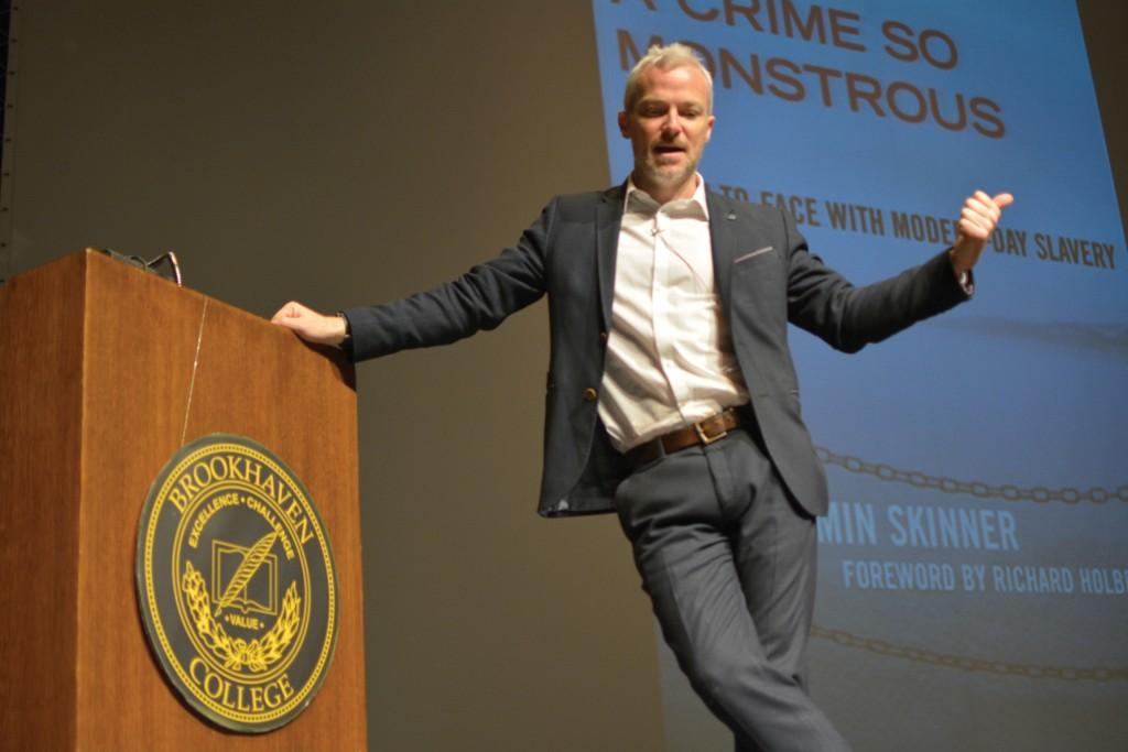 """E. Benjamin Skinner, author of """"A Crime So Monsterous: Face-to-Face with Modern Slavery,"""" speaks to students, staff and faculty in the Performance hall on Feb. 2."""