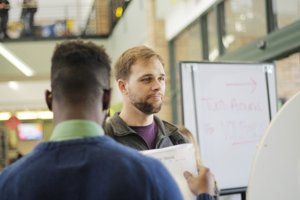 Photo by Ravin Ren | Aaron Pape, a student, answers trivia questions at Brookhaven College's Black History Month Trivia Event Feb. 9 in S Building lobby.