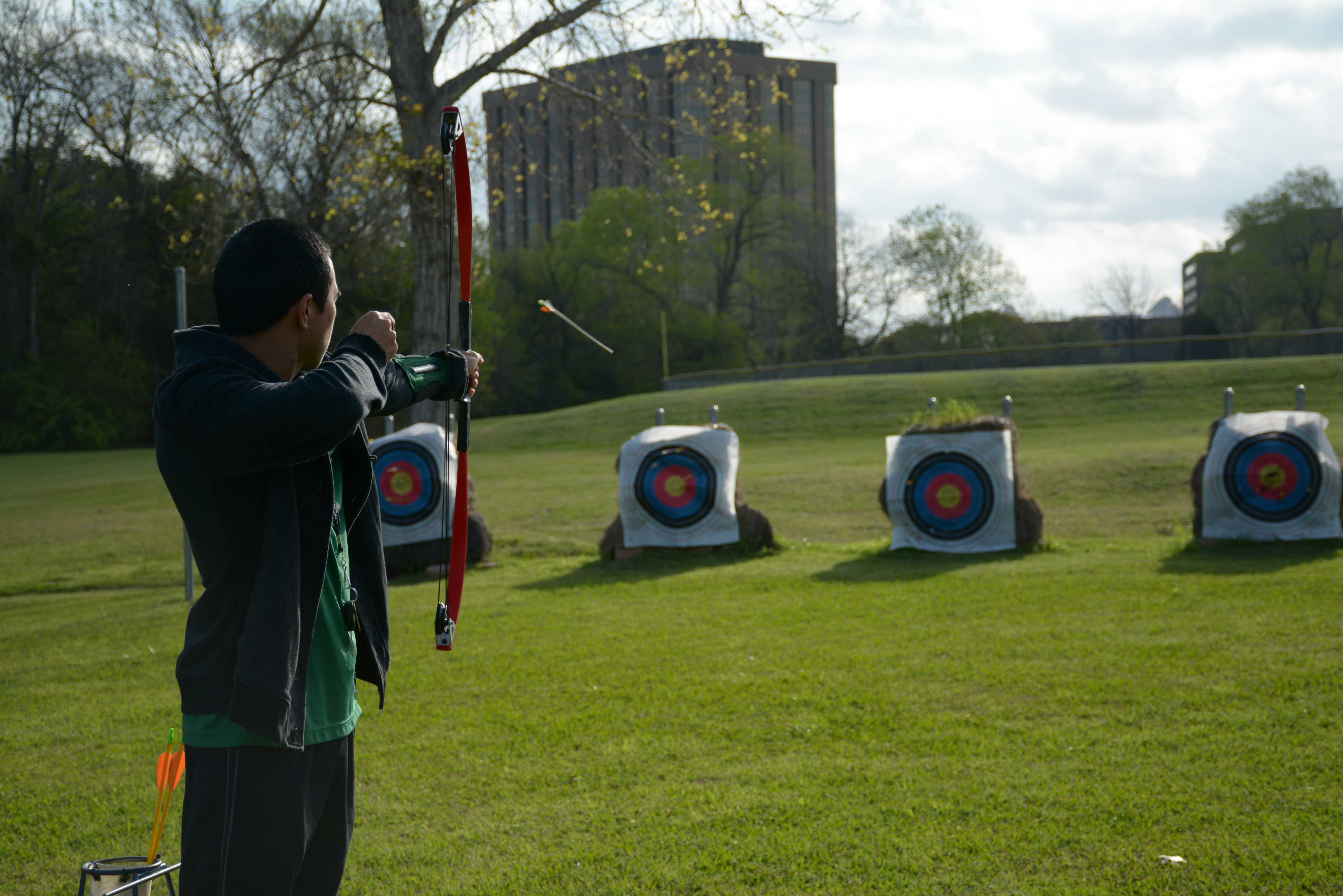 Ribery Kinsella, a student, shoots an arrow with a compound bow