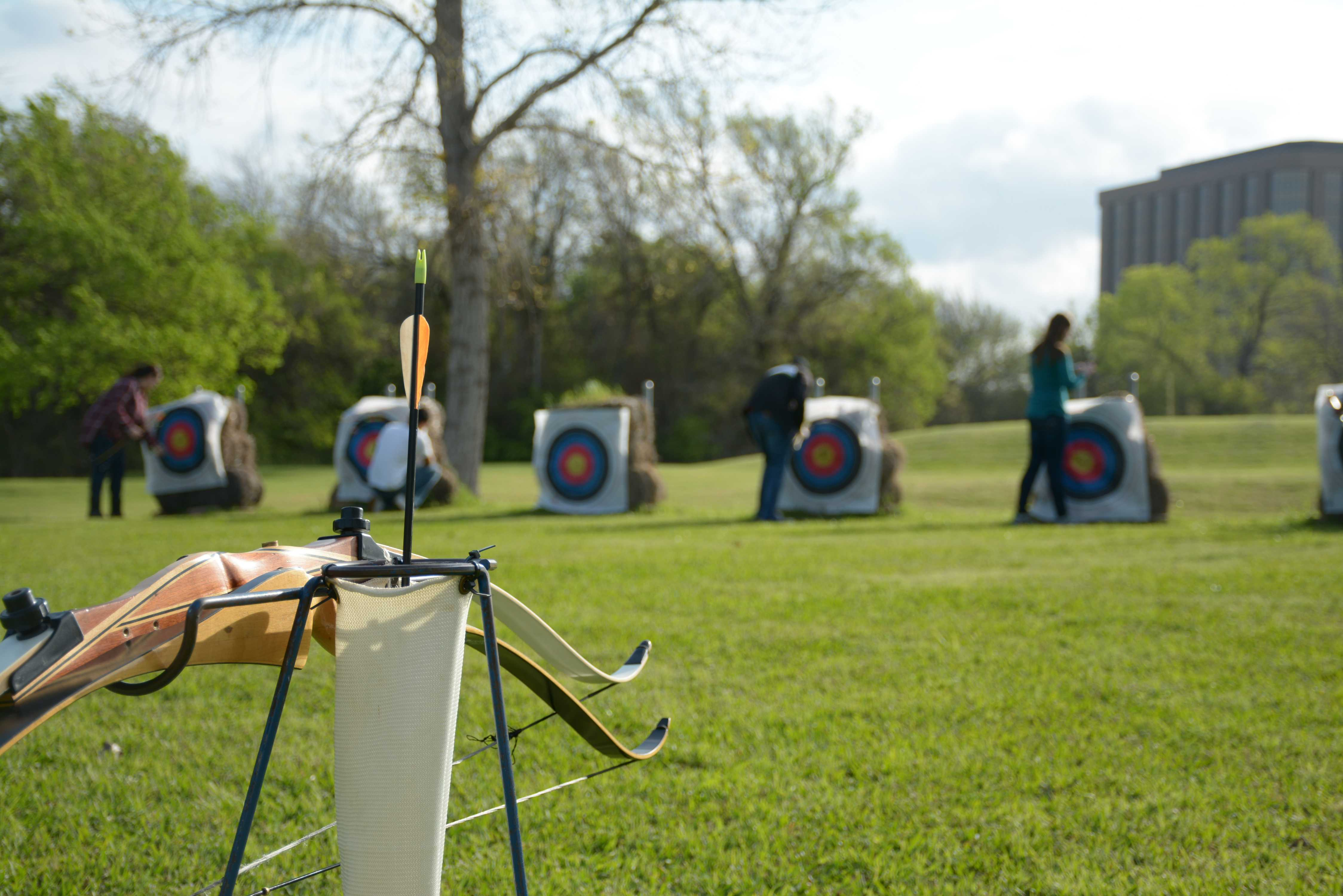 a single arrow is left in the quiver as archery students retrieve their shots and total their scores