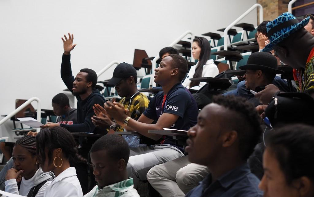 "Photo by Jubenal Aguilar | International student Kassy Legrand, from Ivory Coast, raises his hand to the beat of ""We Are One (Ole Ola),"" the official song of the 2014 FIFA World Cup by Pitbull featuring Jennifer Lopez and Claudia Leitte as everyone else sings along."