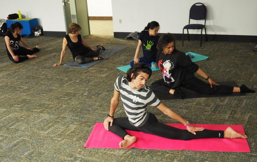 Photo by Jubenal Aguilar | ESOL students and faculty practice yoga as one of the sports activities in the ESOL Sports program. The class is led by Mohemed Almohaid (bottom), a student from Kuwait.