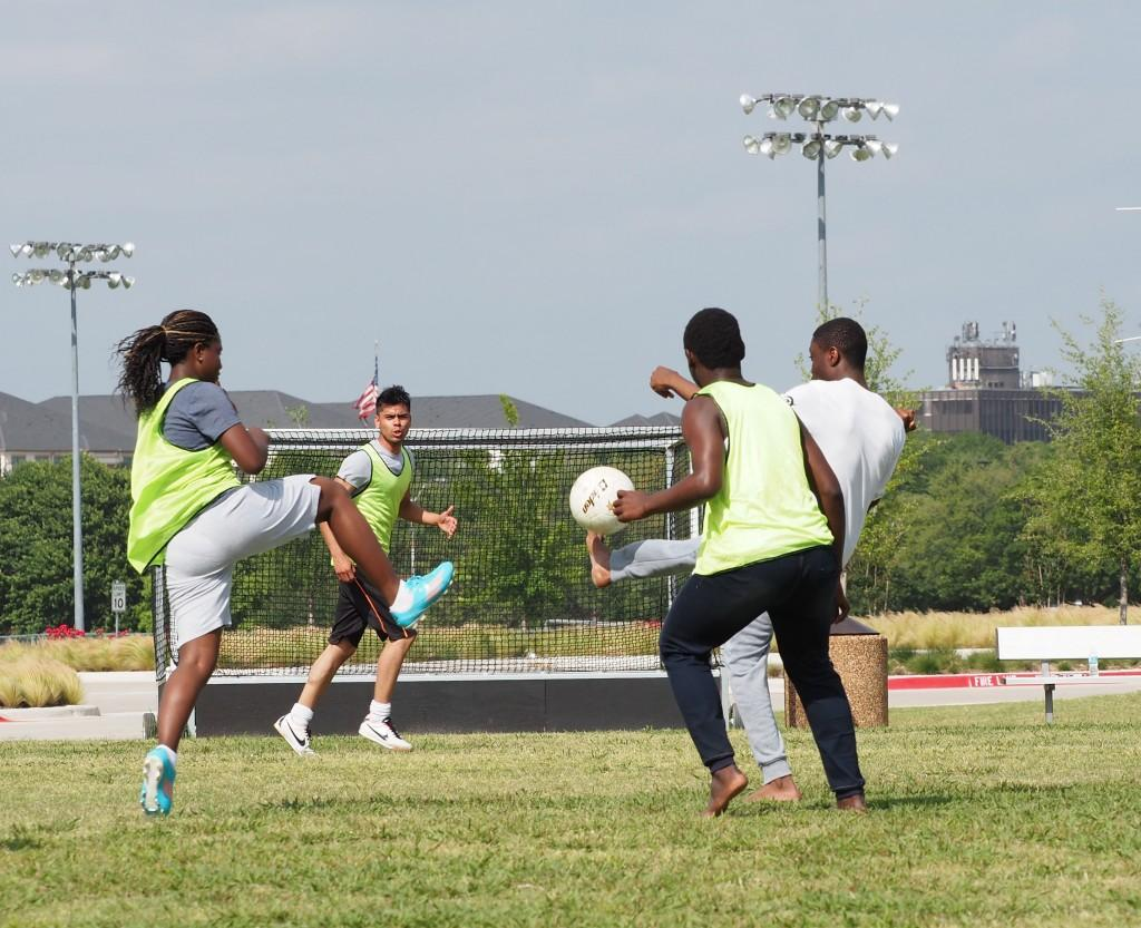 Photo by Jubenal Aguilar | International students Naima Abdoulaye, from Chad; Alberto Solorio, from Mexico; Roger Dasset, from Ivory Coast; and Kppnorh Modest, from Benin, go after the soccer ball.