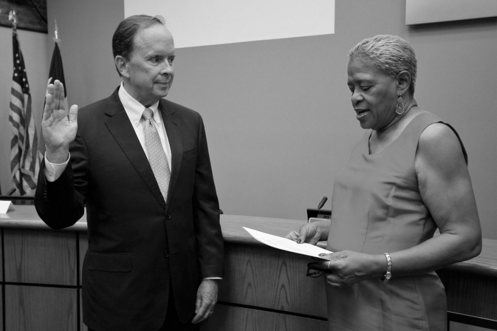 Photo courtesy of Ann Hatch Charletta Rogers Compton, board of trustees chair, swears in District 2 trustee-elect Philip Ritter on June 7.