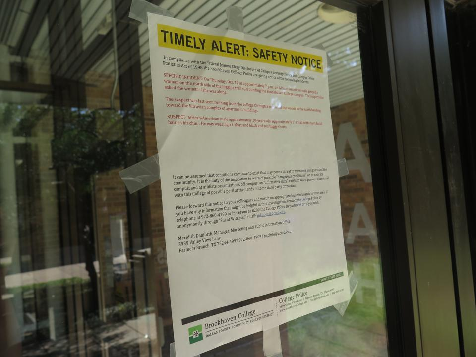 Photo by Diamond Victoria Alerts regarding a recent attack of a woman on the jogging trail are taped on doors throughout campus.