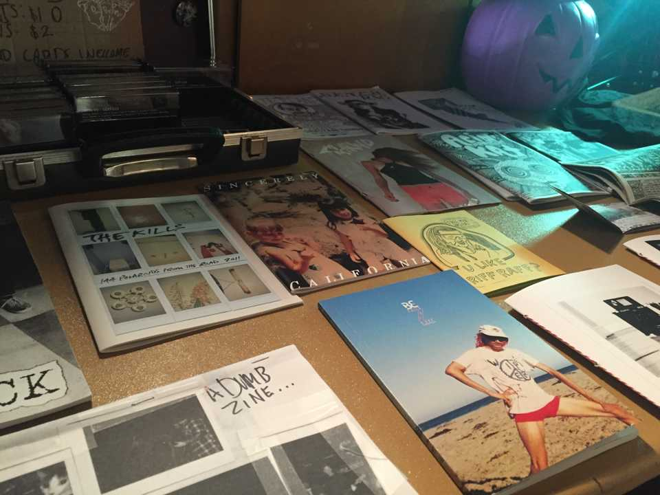 Photo by Jubenal Aguilar Several DIY zines line the tables at the Zine Swap.