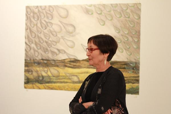 Photo by Amy Price | Artist Judy Youngblood discusses one of her pieces during the reception.