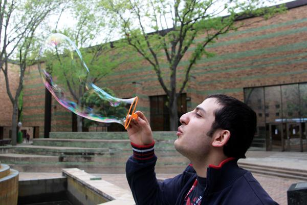 Photos by Ardy Badakhshanian |  Student Baruk Bakirdoven blows up a bubble in celebration of Earth Day.