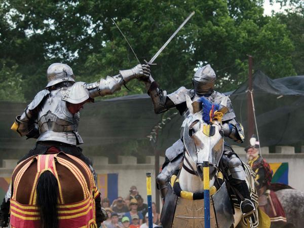 Knights reenact a joust.