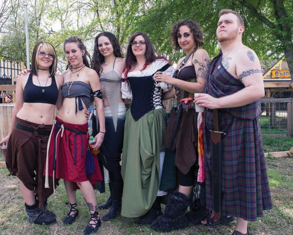 Photos by Earl Ward    Sparrow Dynamic, Brookhaven student Kelley Franklund (derby name WreckLiz N Dangerous), Ares Fury, Diablo Codeine, and Slayer Delilah of Assassination City Roller Derby pose in their festival dress with Tim.
