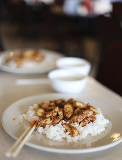 Photos by Scott Mitchell |  A plate of white rice soaks flavor from marinated chicken.