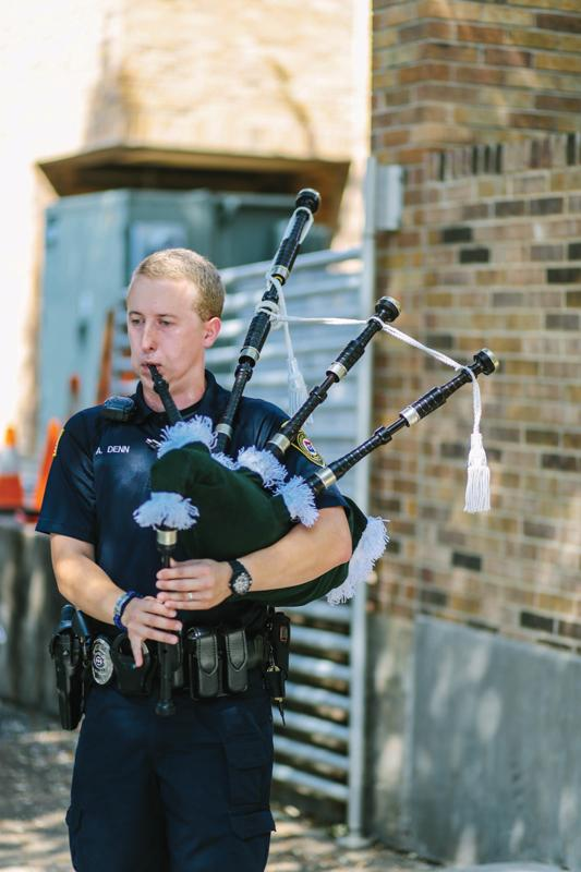 Photo by Kathy Tran | Brookhaven College Police Department Officer Aaron Denn plays for a crowd on campus at the Piper Awards.