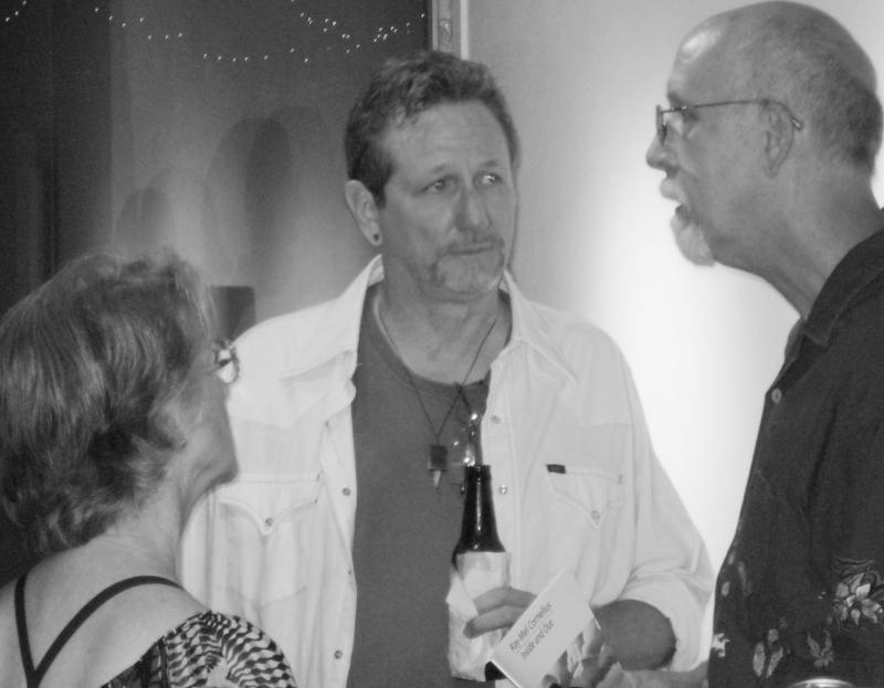 Photos by Chris R. Allison | Cornelius mingles with guests at the gallery