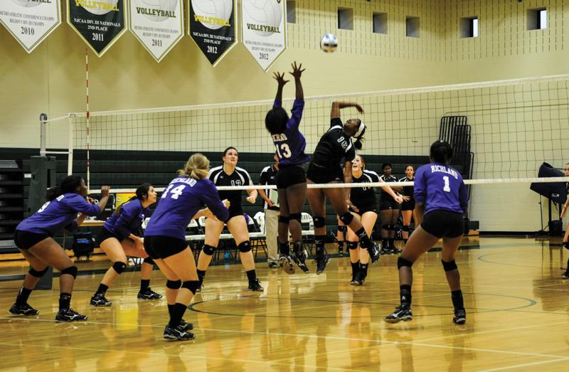Kim Parker, middle blocker, jumps for an aggressive attack