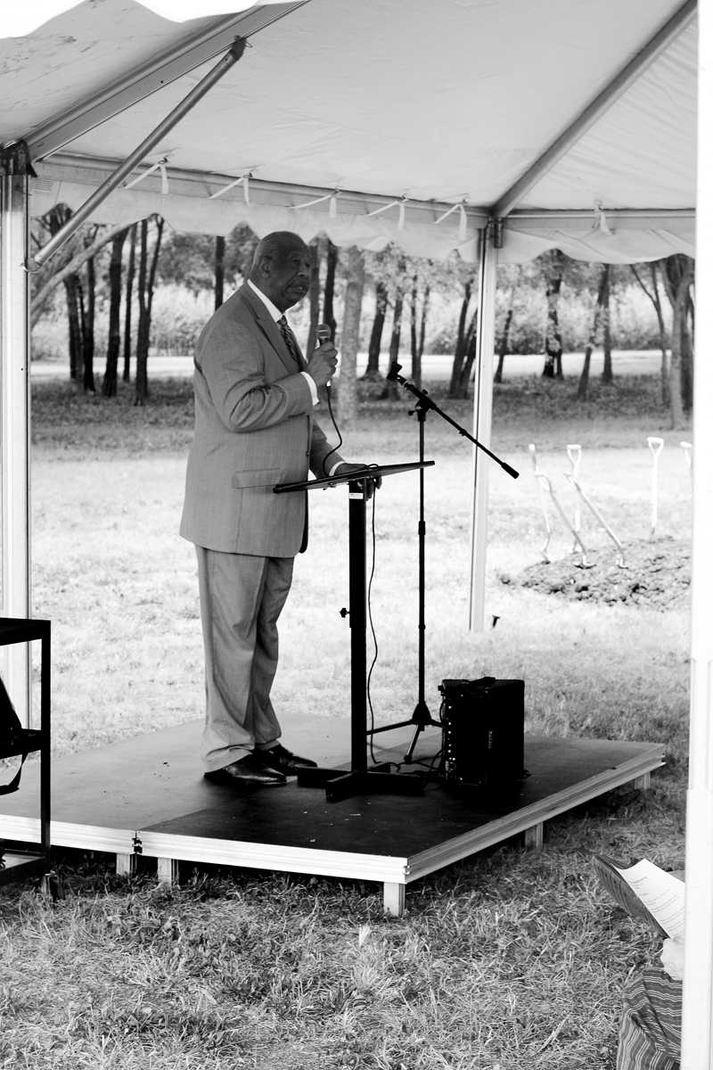 Photo and map by Nicholas Bostick and Scott Mitchell | DCCCD Chancellor Dr. Wright Lassiter speaks to the crowd at the groudbreaking for the trail expansion Sept. 18