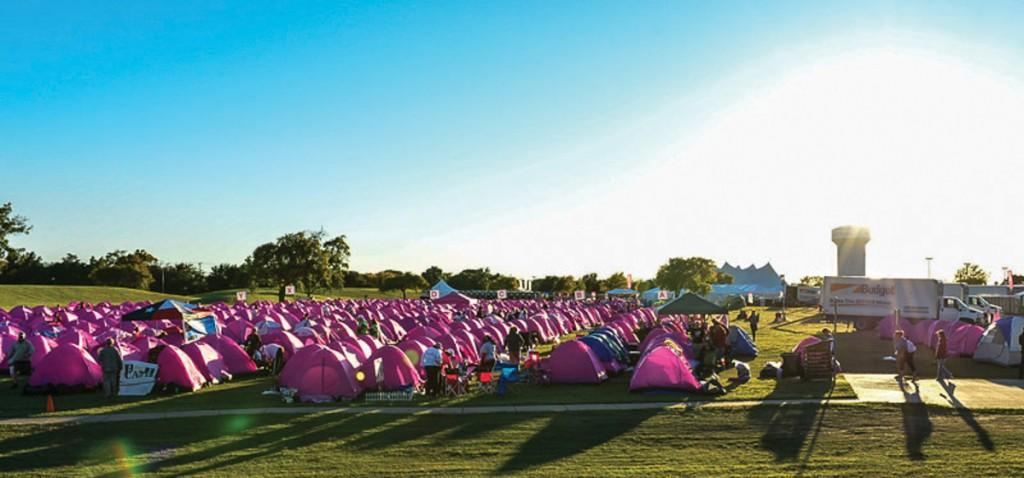A landscape of pink tents for the Susan G. Komen Race for the Cure, a breast cancer awareness event, surrounds Brookhaven College campus as the sun sets Nov. 2.