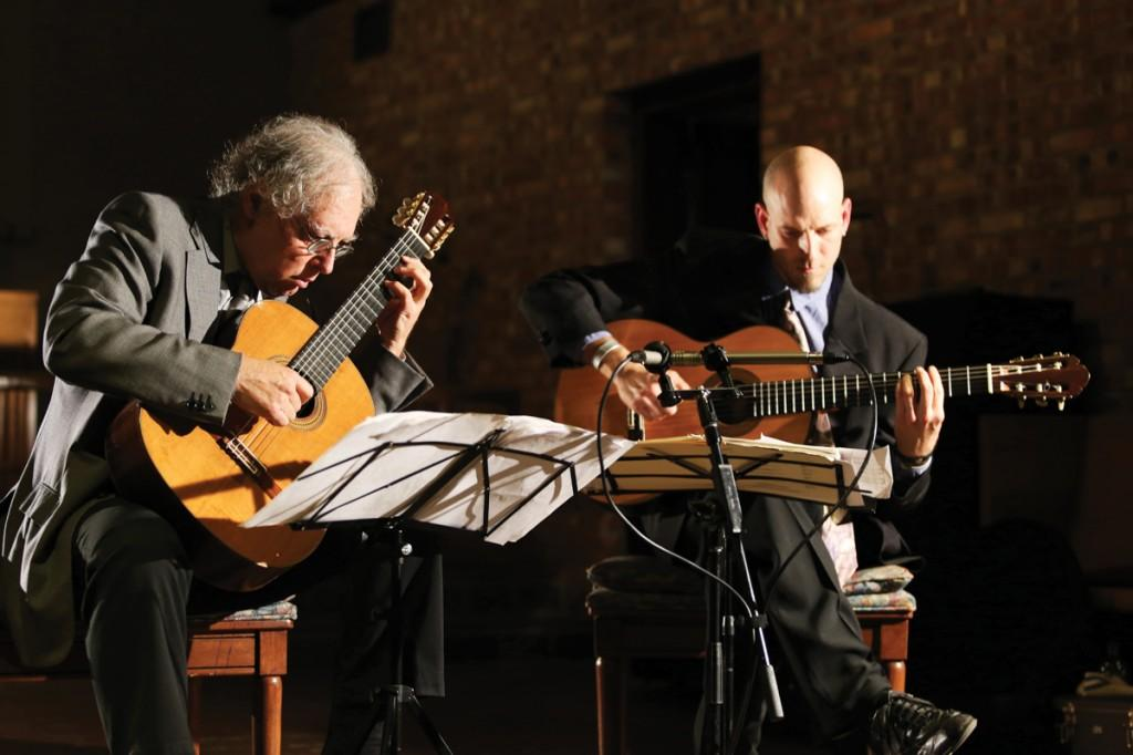 Photo by Scott Mitchell | Guitarists Carlo Pezzimenti (left) and Brian Rowe perform for an audience at Texas Woman's University's Little Chapel-in-the-Woods.