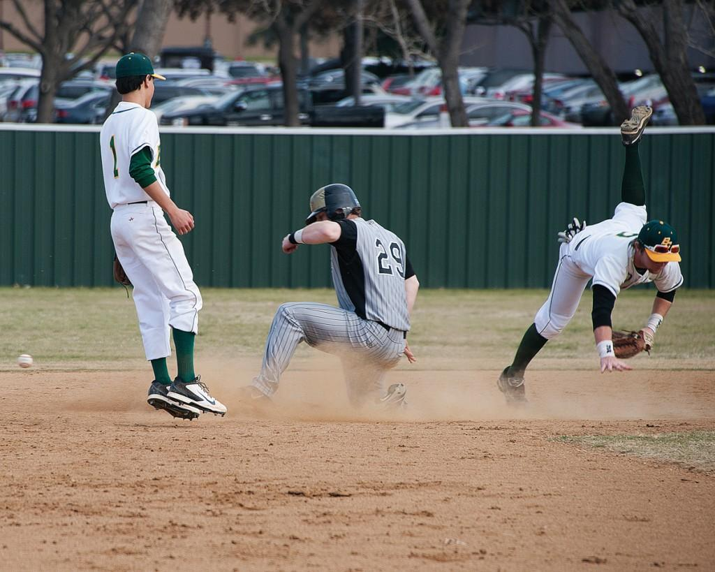 Weatherford's sliding base runner disrupts second baseman Byron Brooks' attempt to tag him during his attempt to steal second base.