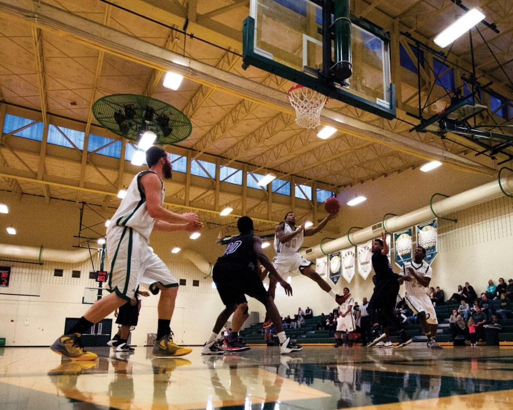 Photos by Scott Godbey and Brian Finch | Kenny Slocum (#10) pulls up for a jump shot in the defender's face after manuvering through the defense