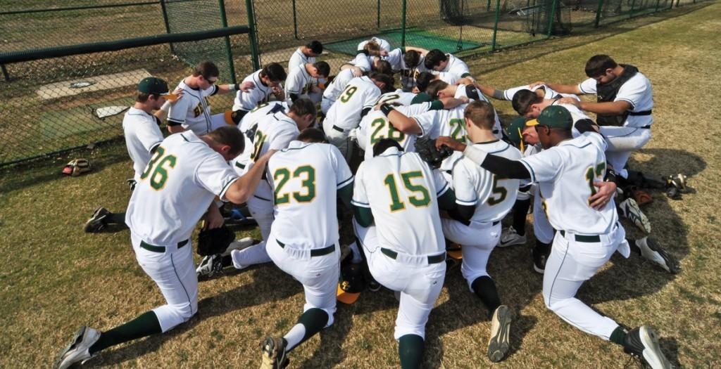 The Brookhaven team kneels together as they settle in and prepare for the start of the game.