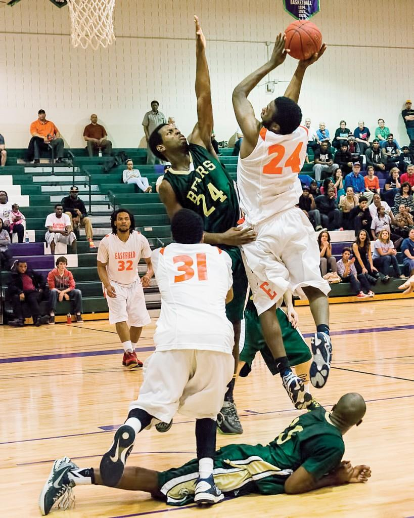 Photo by Scott Godbey | Brookhaven guard Tray Baldwin (#24) attempts to block the shot after guard Curtis Gile (#33) unsuccessfully attempted to steal the ball from an Eastfield offensive player.