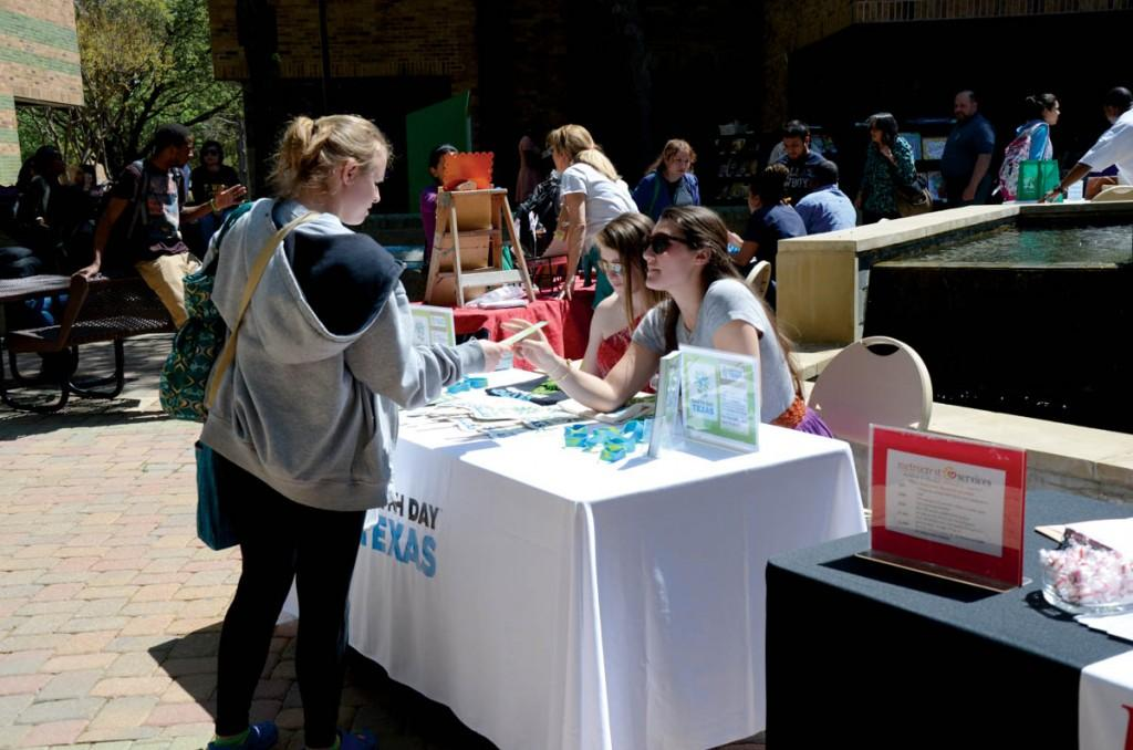 Photo by staff photographer | Brookhaven College student visits one of the booths at the annual Earth Day Fest.
