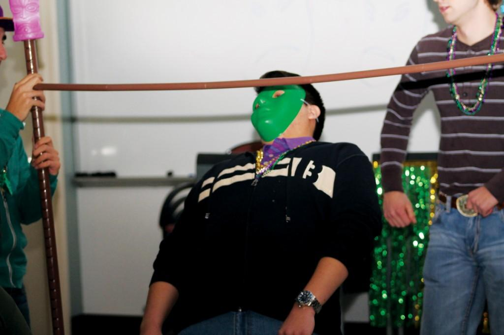 Photos by Ravin Lee | Students embraced the spirit of Mardi Gras by donning masks and celebrating with food and dance.