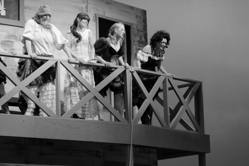 Photos by Ravin Lee | Debbie Stromquist, Chloe Hedrick, Rebecca White and Mar Llavador stand seductively on the second story of the saloon.