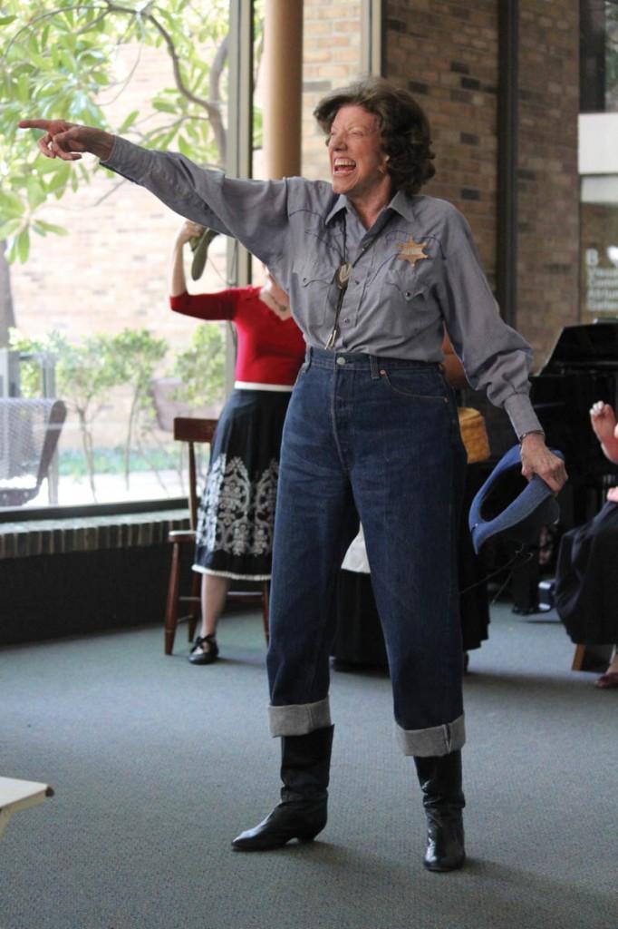 Photos by Brigitte Zumaya    An expressive Sara Lundsteen dresses as a sheriff for her performance.