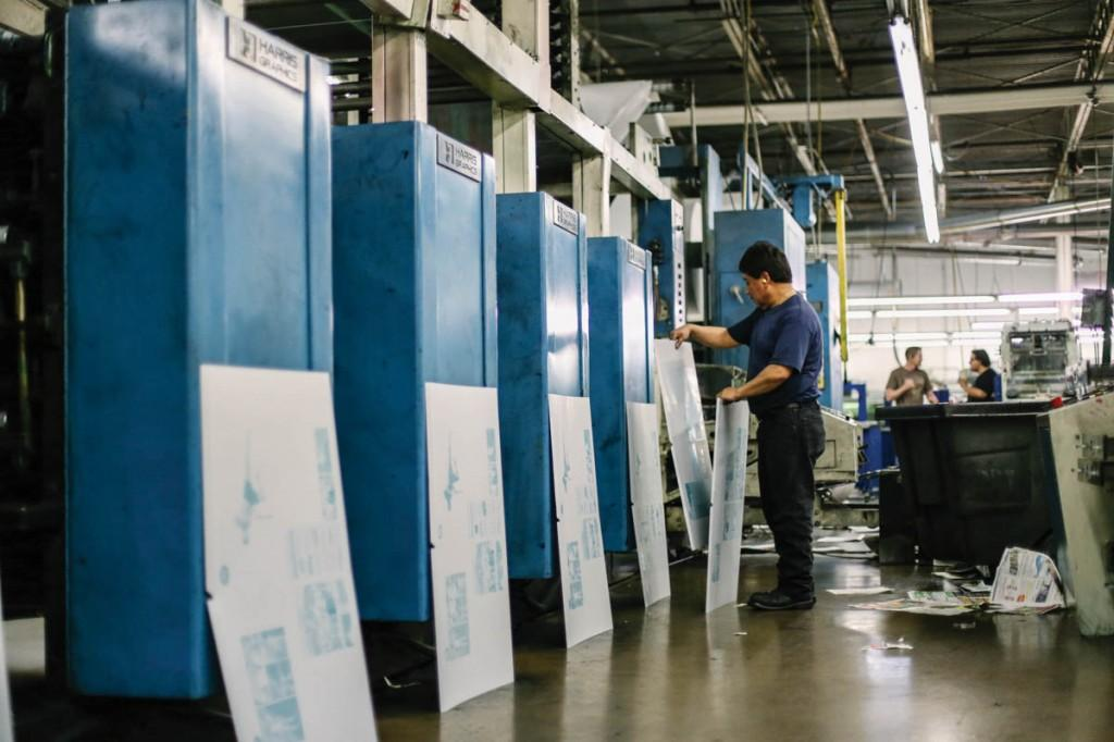 Pages of content are printed on metal plates and set aside by each machine in correct page order for printing.