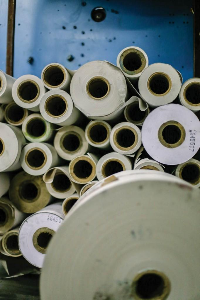 Rolls of papers are stacked and ready to supply the machines.
