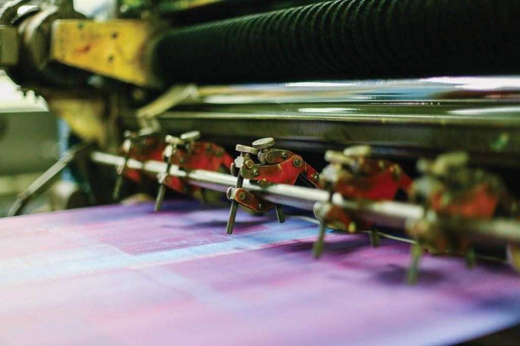 The printing machine uses Harris cold set presses to ink the pages.
