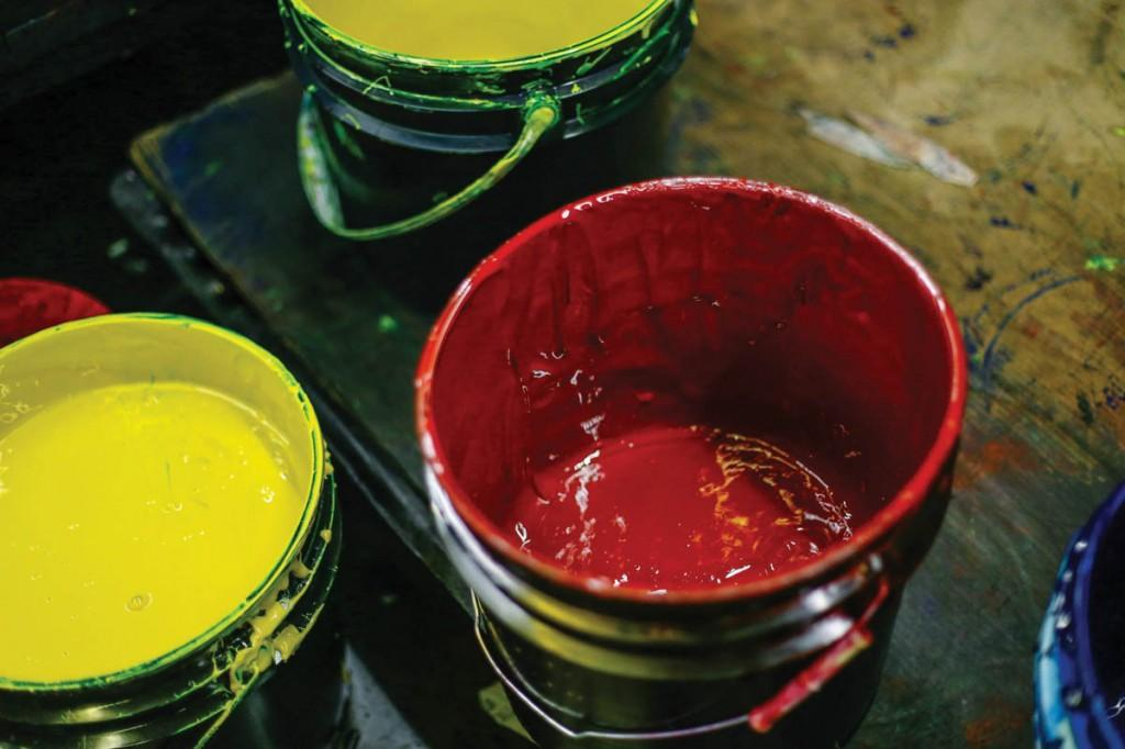 Buckets of 4cp news- print ink, used for the presses, lay out in the open.