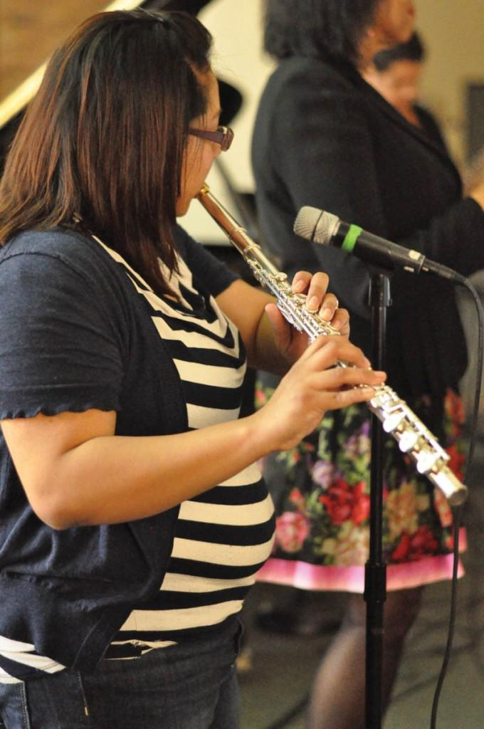Martha María Zamora skillfully plays her flute and keeps the Latin rhythms with the rest of the student ensemble.