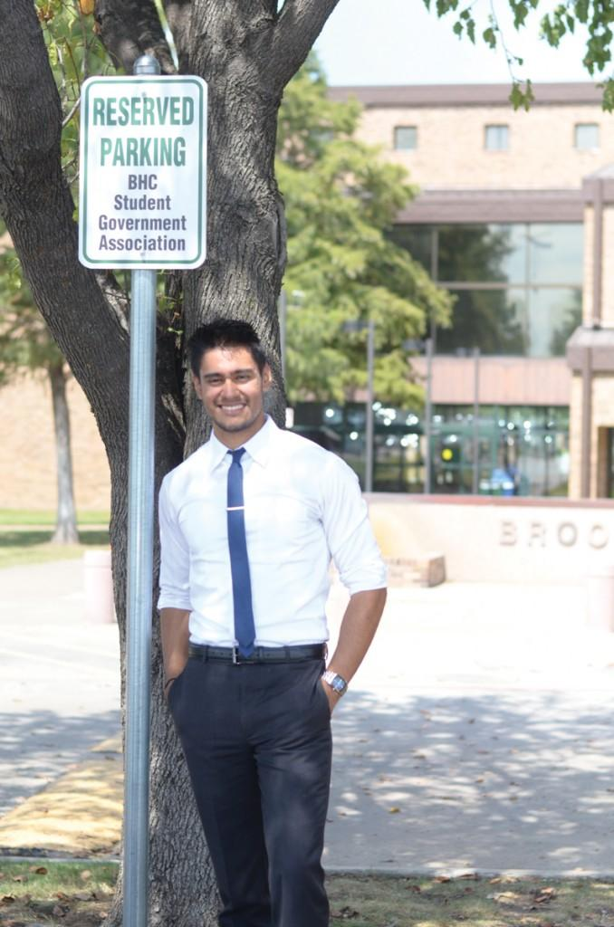 Photo by Travis Baugh | SGA president Jordan Cisneros stands in front of his former parking spot.