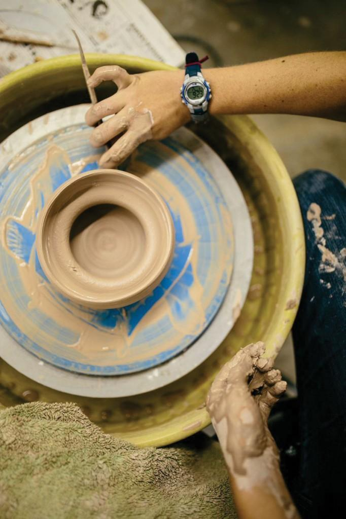 Photos by Kathy Tran |The bottom of this bowl is being rounded out by a student.