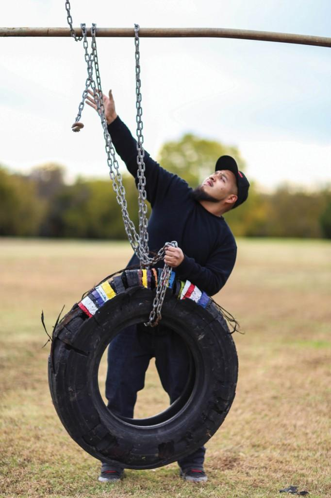 """Photos by Kathy Tran   Gonzalez works with his installation """"My Childhood Labor,"""" which was displayed spring 2013 at Brookhaven College as part of a sculpture class assignment to create a piece based on home."""