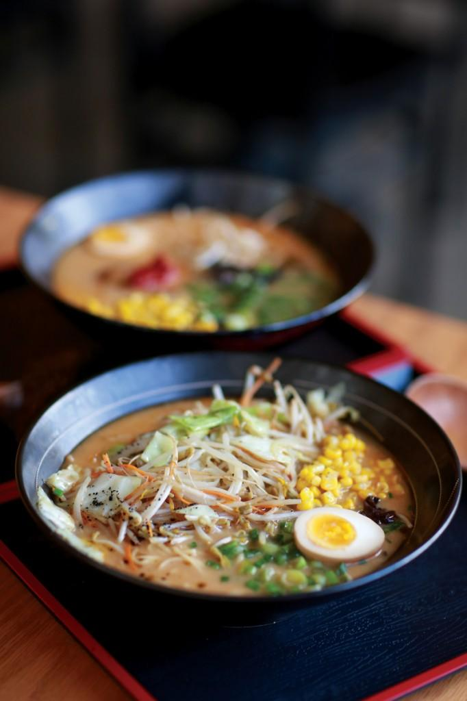 Photo by Adriana Salazar | A steaming bowl of vegetable miso ramen sits in front of a bowl of spicy miso ramen.