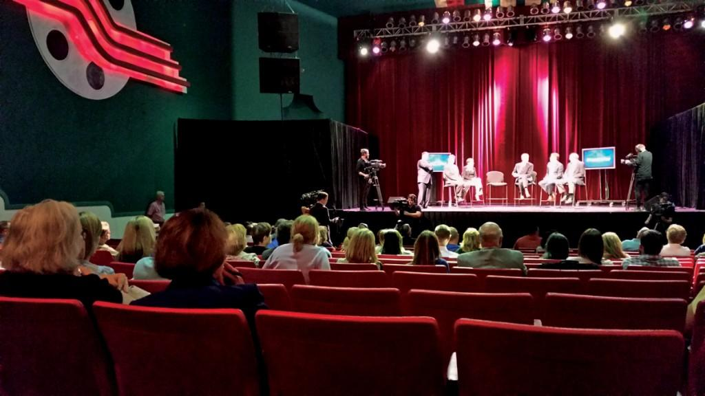 Photo by Tyler Satchwell | The audience asks questions and listens to panelists address Ebola concerns while WFAA-TV films the Facts Not Fear event at the Lakewood Theater.
