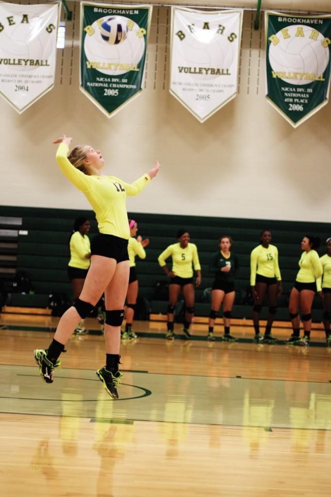 Middle blocker Samantha Eaton launches for a jump serve during the championship game.