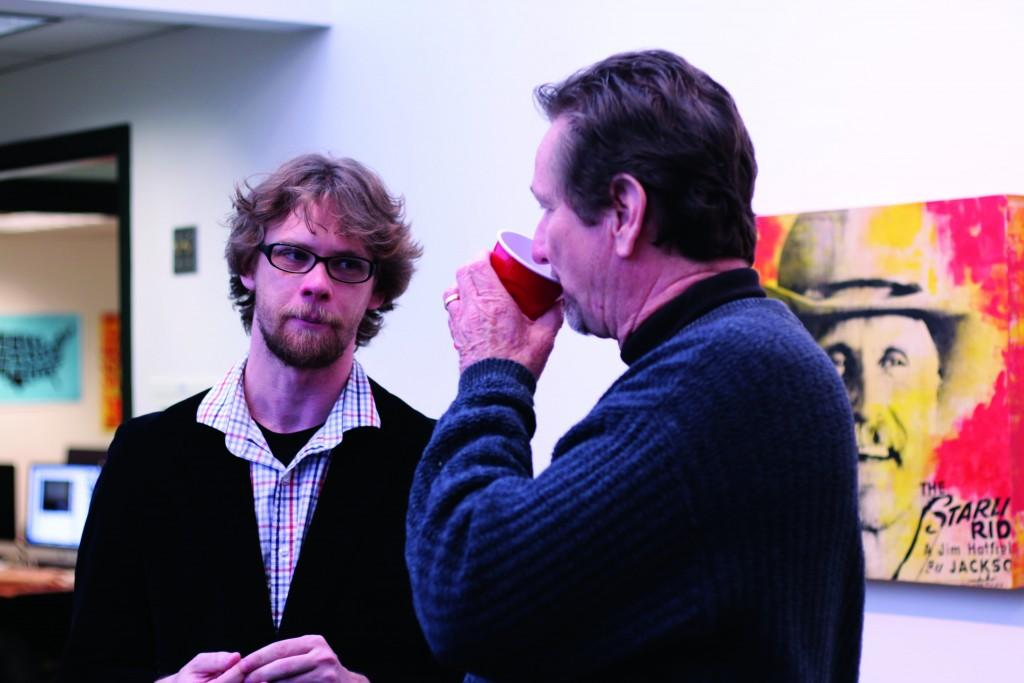 Director of the Atrium Gallery, Ray-Mel Cornelius (right), talks art with Jonathon Kimbrell (left).
