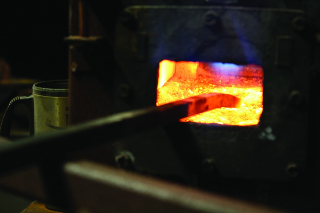 A propane forge heats metal to make it flexible.